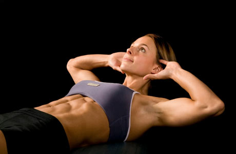 Woman Doing a Sit Up abdominal muscles